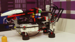 The robot quickly collects a cube of rubik. Modern robotic technologies Footage