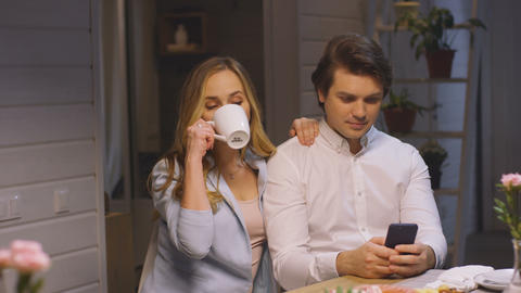 Woman Drinks Coffee Offers Boyfriend to Take Photo Stock Video Footage