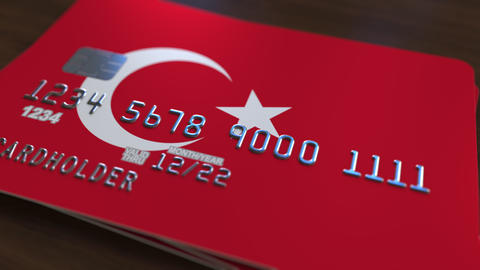 Plastic bank card featuring flag of Turkey. National banking system related Footage