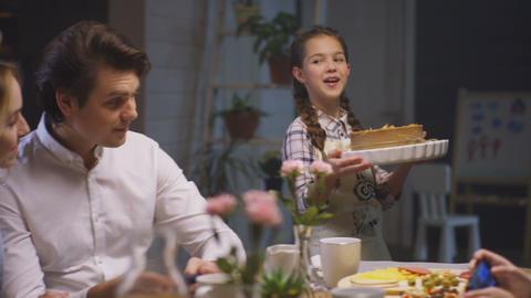 Parents Discuss Surprised by Daughter Bringing Pie Footage