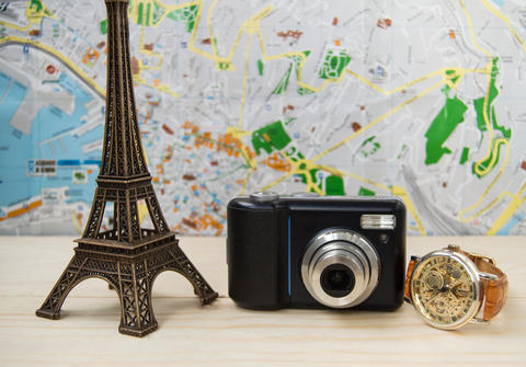 Planning a vacation, trip with map. Camera, clock, Eiffel tower Photo