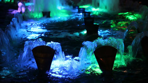 Beautiful water fountain flowing at night Image