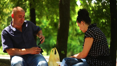 Adult Couple On A Bench Footage
