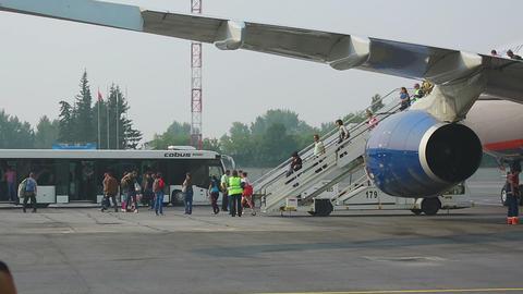 Passengers leaving plane Footage