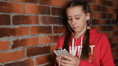 Girl with headphones listening music Footage