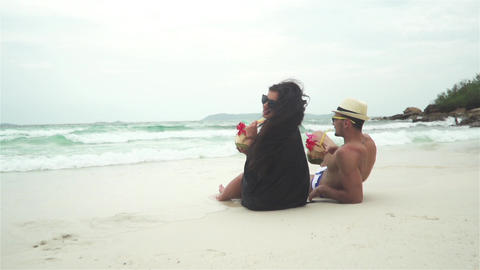 Happy Young Couple Lying On A Tropical Beach Footage