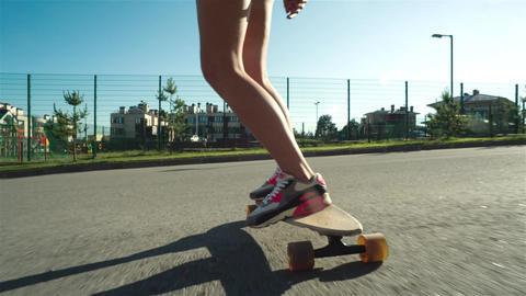 Teenage Girl In Sunglasses Riding Skate Footage