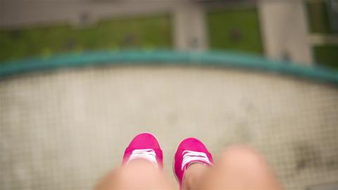 Female Legs In Pink Sneakers Swinging Footage