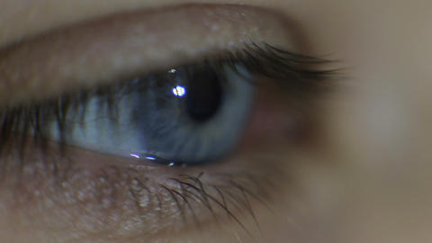 blue eye in macro footage of young handsome man Footage