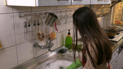 Young girl washing plate Footage