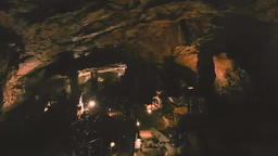 Large group of adult tourists exploring the Saeva Cave in Bulgaria going down ビデオ