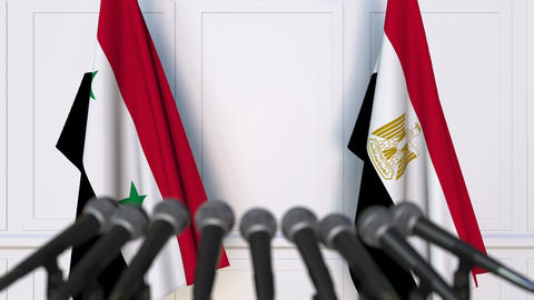 Flags of Syria and Egypt at international meeting or negotiations press Footage