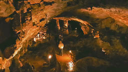 Group of adult tourists exploring the Saeva Cave in Bulgaria 영상물