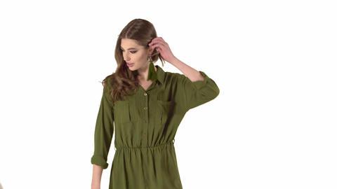 Girl in dark green dress on white background Footage