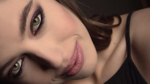 Beauty Brunette Woman with Perfect Makeup. Beautiful Professional Holiday Make Footage