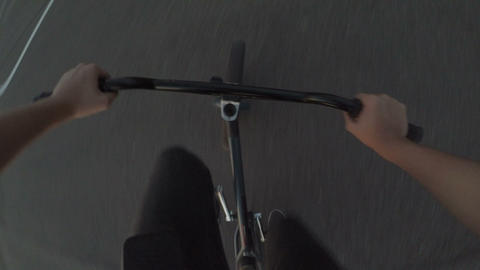 POV of young biker enjoying riding on his bike practicing tricks and moves Footage