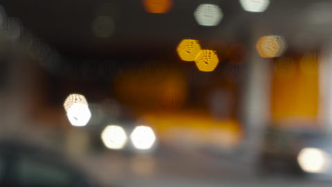 Bokeh light effects from car light driving in a tunnel - out of focus footage ビデオ