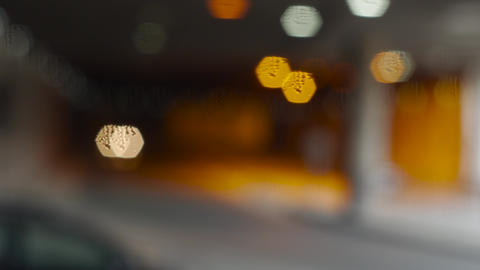 Bokeh light effects from car light driving in a tunnel -... Stock Video Footage