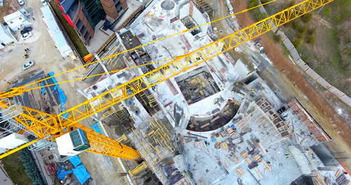 Aerial shot large crane on a building construction site Footage