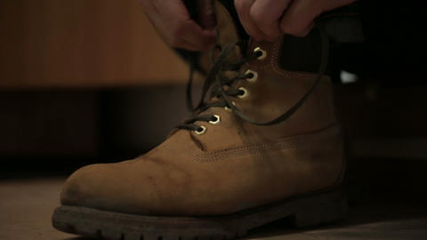 man clothes and tying his shoes Footage