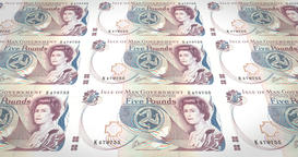 Banknotes of five manx pounds of Isle of Man rolling, cash money, loop Animation