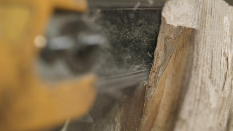 Cutting through wood with chainsaw in slow motion Footage