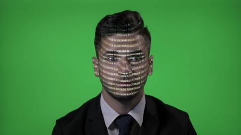 IT businessman at work with projected computer blockchain code on face blinking Footage