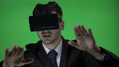 Happy young man wearing formal suit with 3d vr glasses to scroll and type in Footage