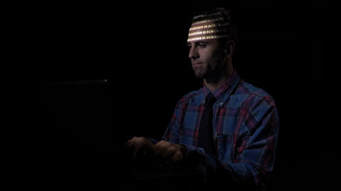 Serious corporate programmer sitting at the desk typing data about blockchain Footage