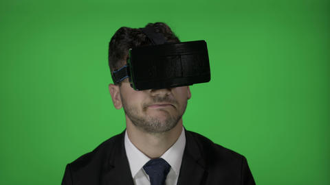 Elegant male candidate experiencing job interview using virtual reality goggle Live Action