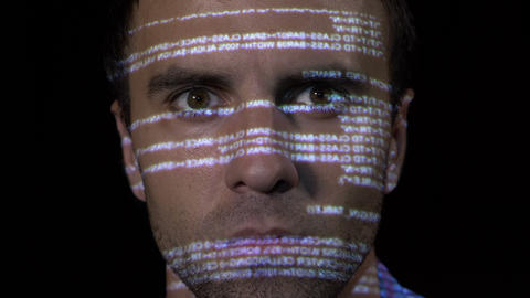 Portrait of a young IT programmer cyber worker male working on antivirus program Footage
