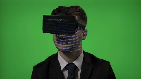 Close up of a computer programmer man dressed in suit coding on vr augmented Footage