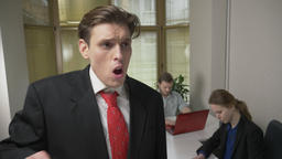 Young man in a suit is coughing, sick, a disease concept. Man and the girl in Footage