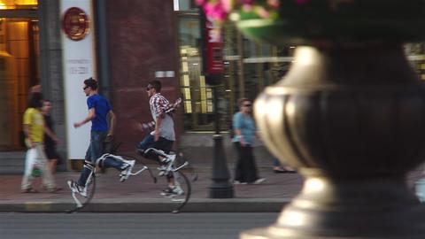 Men Running On Jumping Stilts Footage