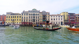 Gondolier and Gondola at Venice grand canal. The Gondola is a traditional, flat- Footage