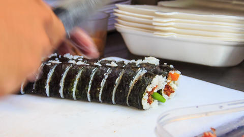 Hands Cut Sushi with Knife Put into Lunch-Box Live Action