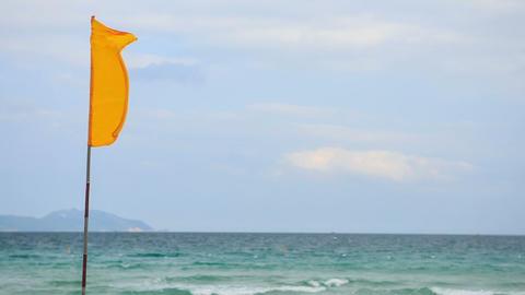 Closeup Wind Flaps Banner on Flagstaff on Sea Footage