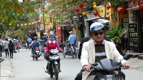 Group tricycle drivers in the street of the old town of Hoi An Footage