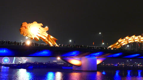 Dragon bridge with in the background fireworks celebrating Chinese New Footage
