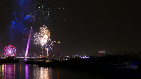 The Trần Thị Lý Bridge and Sun Wheel with fireworks celebrating Chinese New Footage