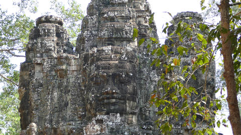 Close up from the face of one the gates at Angkor Wat Footage