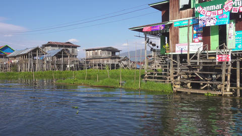 Stilted houses in village on famous Inle Lake Footage