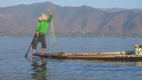 Fishermen in a canoe on famous Inle Lake Footage