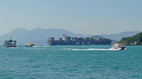 Container ship and boats in harbor of Hong Kong Footage