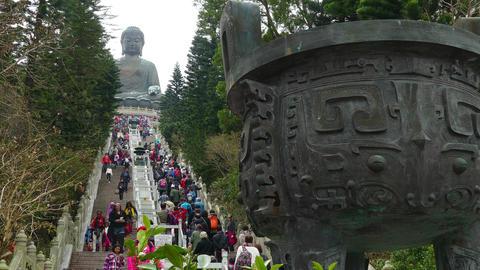 People climb the stairs to Tian Tan Buddha Footage