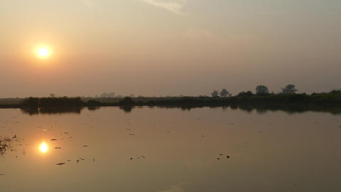 Sunrise reclection in a lake at the countryside Footage