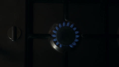 A man lights a gas stove top Footage