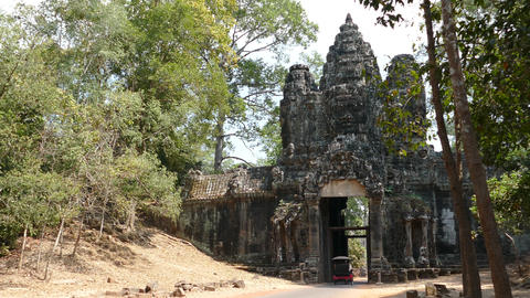 Tuk Tuk drives through one of the gates at Angkor Wat Footage