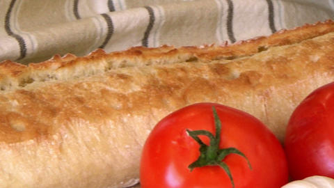 RL Closeup white bread, tomatoes, garlic, cherry tomatoes, mediterranean food Footage