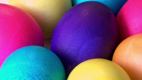 Closeup/macro of Easter painted multicolor eggs rotating Footage